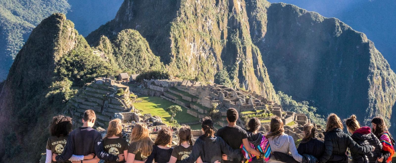 Volunteers on a global gap year visit Machu Picchu on a weekend trip in Peru.